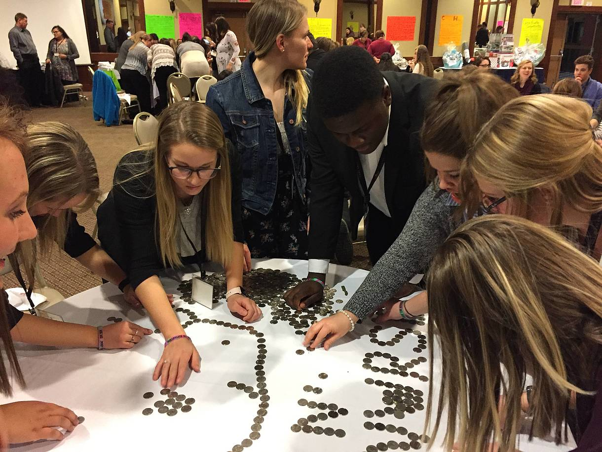 Image of students organizing coins