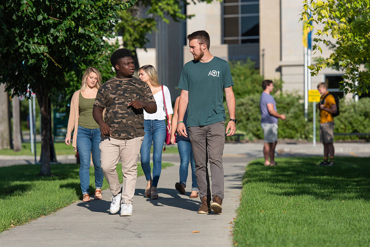 Students walking outside Barry Hall