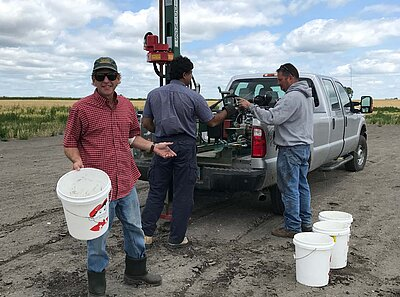 NDSU Extension specialist and agents use a pickup-mounted soil probe to test soil salinity