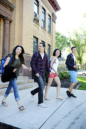 Photo of 4 NDSU Students Exiting Building