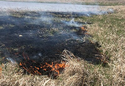 A small patch of rangeland burning
