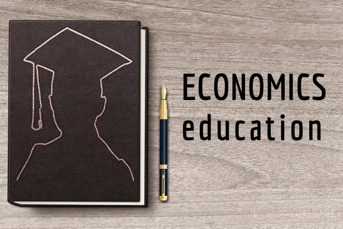 "A notebook with the words ""Economics Education"" next to it"