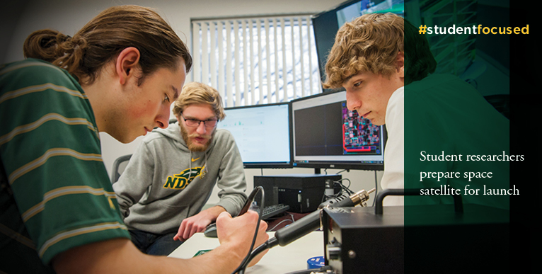 Student researchers prepare space satellite for launch