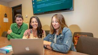 ndsu nursing students looking at a computer