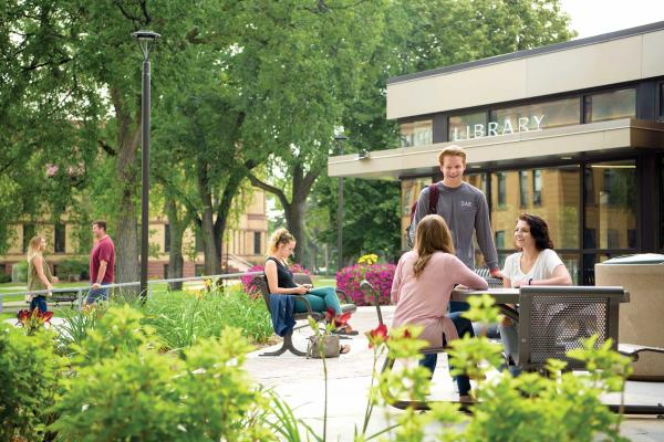 students outside the main library